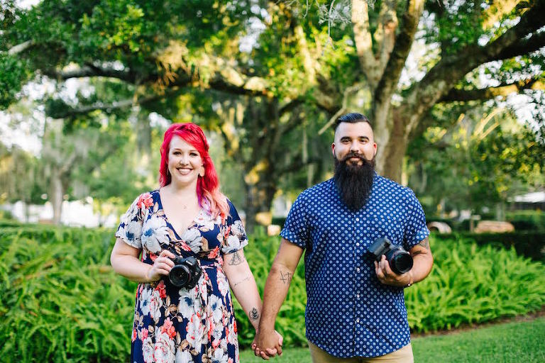 Tampa Bay Wedding Photographer and Videographer | Rad Red Creative Owners Brittany and Leo Trevino Portrait with Cameras