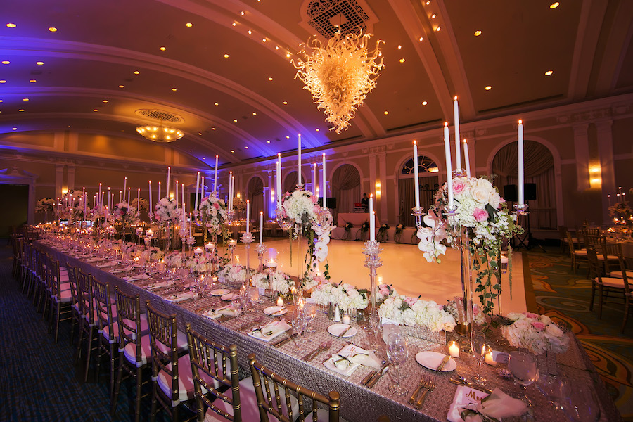 Luxurious and Elegant Wedding Reception Décor with Blush, Gold and Ivory Centerpieces, Tall Taper Candles and Long Feasting Tables at St Petersburg Fl Wedding Venue Vinoy Renaissance Sunset Ballroom   Gold Chiavari Chair Rentals by A Chair Affair   Tampa Wedding Photographer Limelight Photography