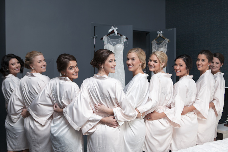 Bridal Party Getting Ready In Custom Monogrammed Bridesmaids Satin Ivory Robes | Tampa Wedding Photographer Carrie Wildes Photography