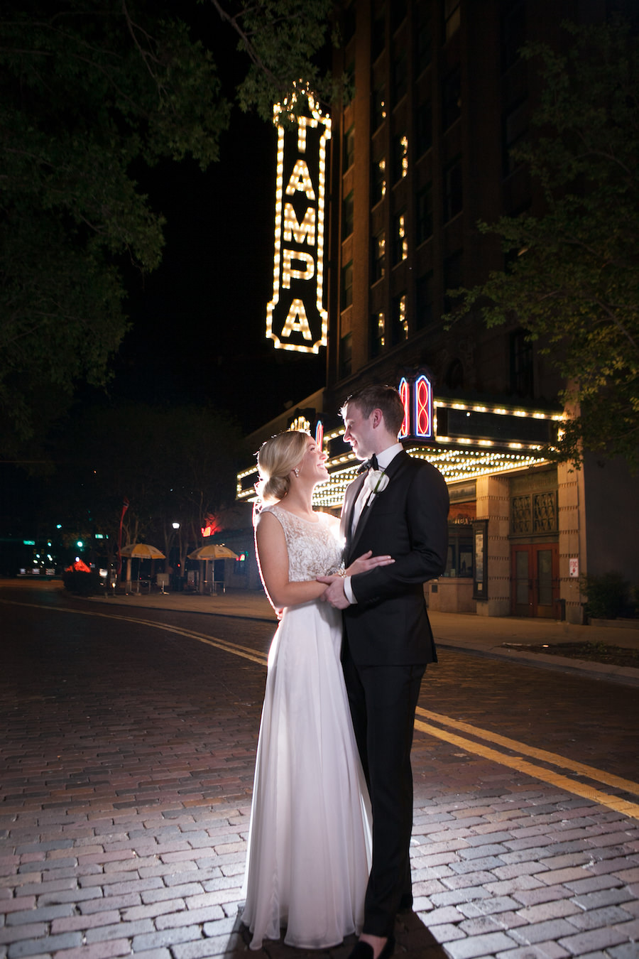 Downtown Tampa Bride and Groom Wedding Portrait In Front of The Tampa Theatre Lighted Sign | Tampa Wedding Photographer Carrie Wildes Photography