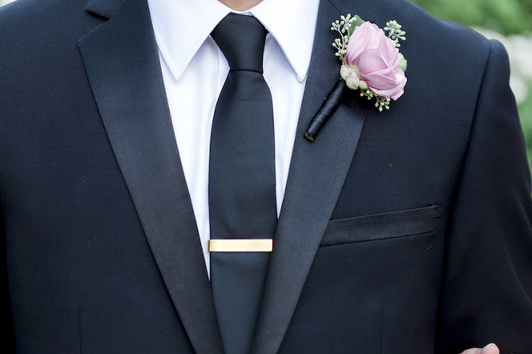 Groom Wedding Portrait in Black Tuxedo with Gold Tie Clip and Blush Pink Boutonnière