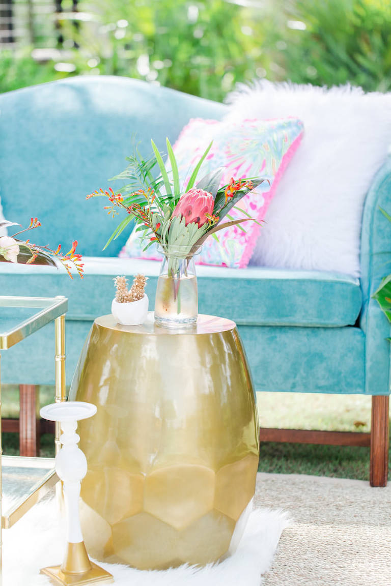 Teal Vintage Couch Wedding Seating Ideas and Inspiration with Eclectic End Tables and Tropical Wedding Centerpieces with Lilly Pulitzer Accents   Tampa Bay Vintage Wedding Rental Furniture The Reserve Vintage Rentals