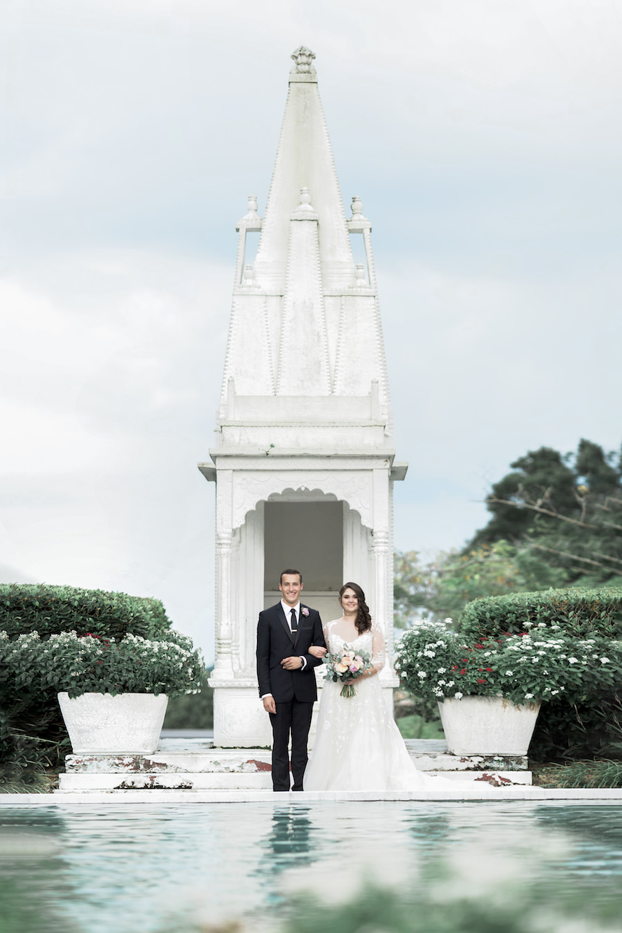 Bride and Groom Outdoor Lakeland Wedding Portrait in Front of Fountain