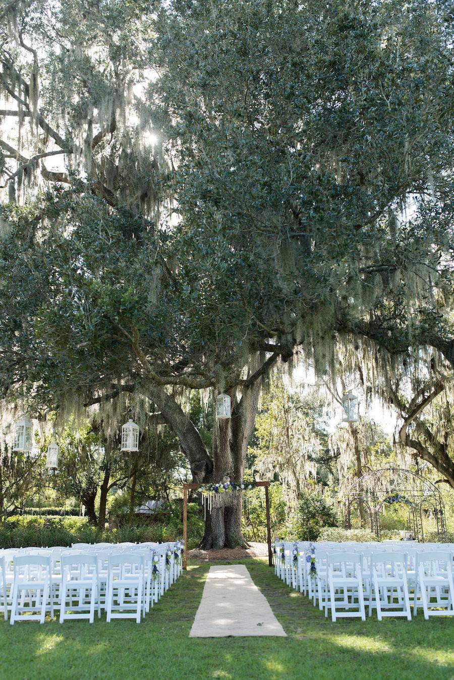 Rustic Outdoor Wedding Ceremony under Spanish Moss Tree at Tampa Wedding Venue Cross Creek Ranch | Photographer Caroline and Evan Photography