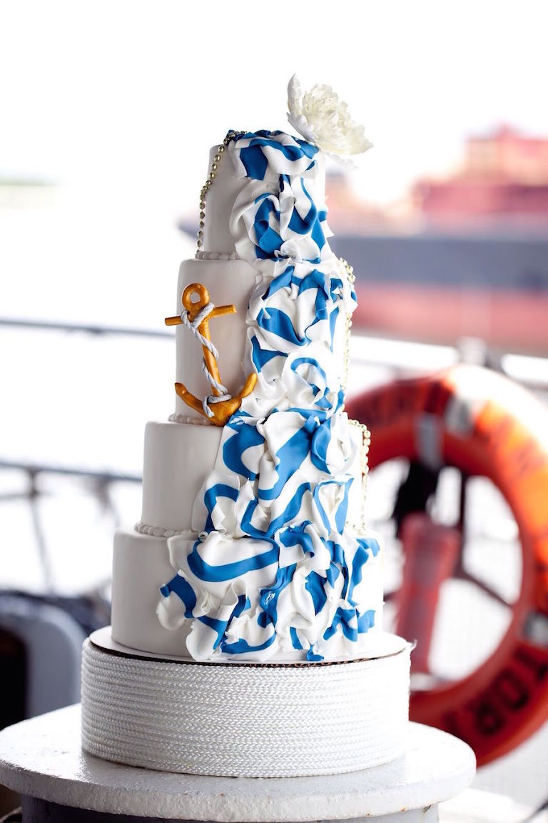Four Tiered Nautical Inspired Wedding Cake with Anchor and Flag Accent | Tampa Wedding Cake Bakery A Piece of Cake and Desserts