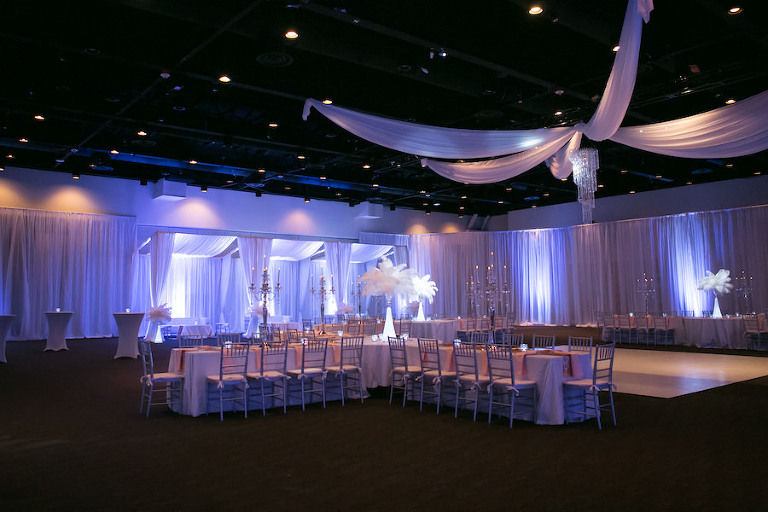 Purple Uplighting and Pin-spotting Lighting Effects for Florida Modern Wedding Reception with Drapery and Chiavari Chairs with Feather Decor by Tampa Event Rental Company Gabro Event Services