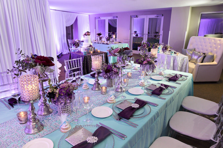 Beaded Glass Charger with Silver Wedding Menu and Purple Napkin with Rhinestone Holder | Purple and Deep Red Centerpieces with Candles on Tiffany Blue Linens with Clear Chiavari Chairs | Wedding Reception Ideas & Inspiration | Special Moments Event Planning | Connie Duglin Linens | Gabro Event Services