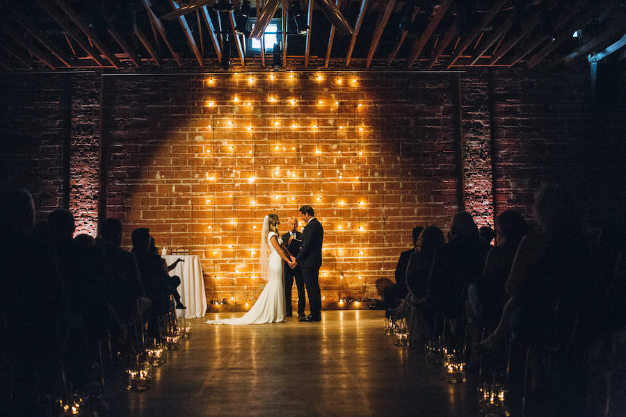 Modern, Industrial Wedding Ceremony with Lighted Backdrop and Brick Wall | St. Pete Wedding Venue NOVA 535