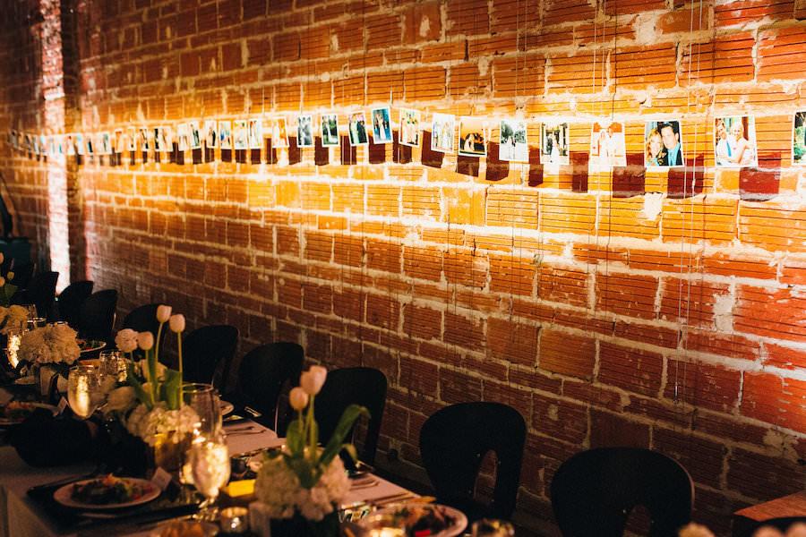 Wedding Photo Reception Display Idea Hanging On Brick Wall   Modern St. Petersburg Wedding Venue NOVA 535