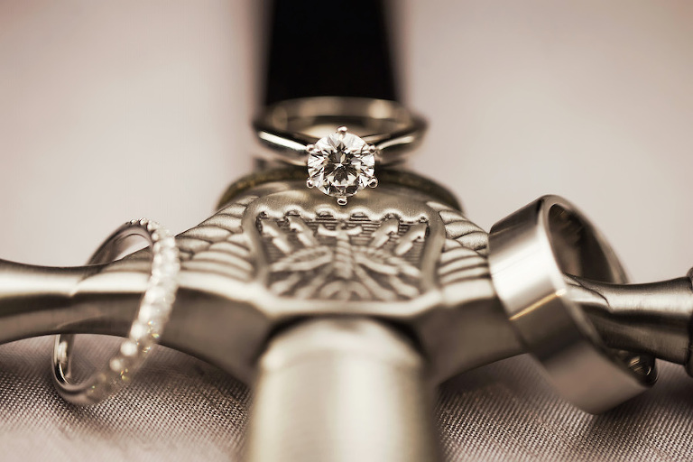 Military Bride and Groom Wedding and Engagement Ring Portrait on Air Force Sword | St. Pete Florida Wedding Photographer Limelight Photography
