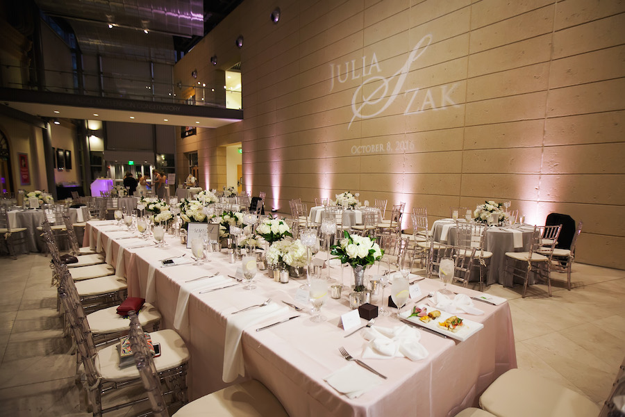 Modern Wedding Reception with Pink Linens and Decor, Long Feasting Tables, Chiavari Chairs, White Rose Centerpieces and Monogram GOBO Lighting | St. Pete Wedding Venue Museum of Fine Art