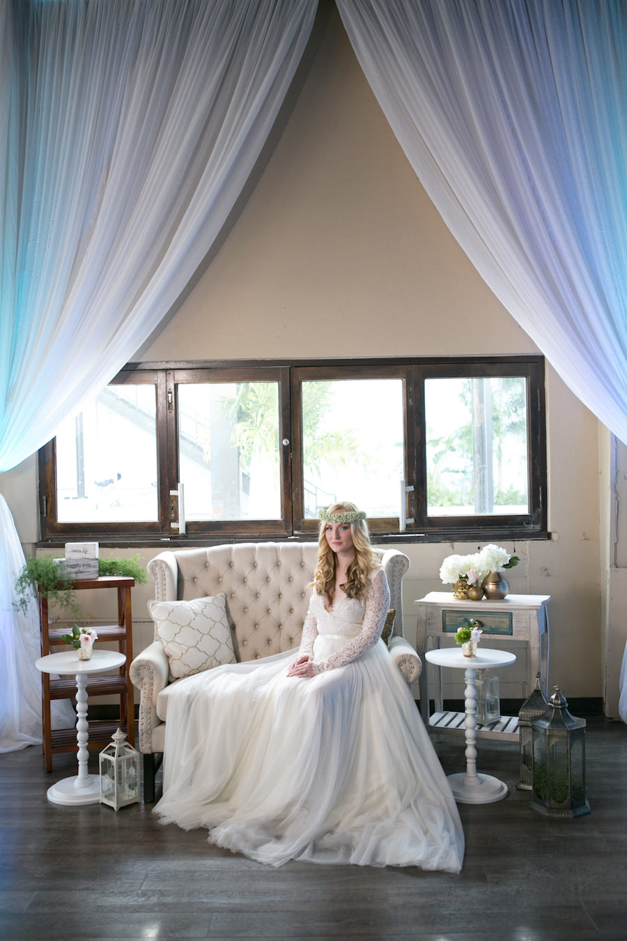 Vintage Tufted Upholstered Couch and Furniture with White Draping | Long Sleeved Lace Wedding Dress from the The Bride Tampa | Boho Wedding Reception Decor Ideas and Inspiration | Tampa Wedding Photographer Carrie Wildes Photography