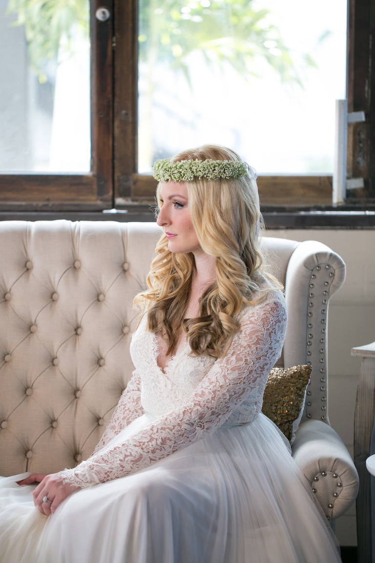Vintage Tufted Upholstered Couch and Boho Bride with Baby's Breath Floral Crown | Long Sleeved Lace Wedding Dress from the The Bride Tampa | Boho Wedding Reception Decor Ideas and Inspiration | Tampa Wedding Photographer Carrie Wildes Photography