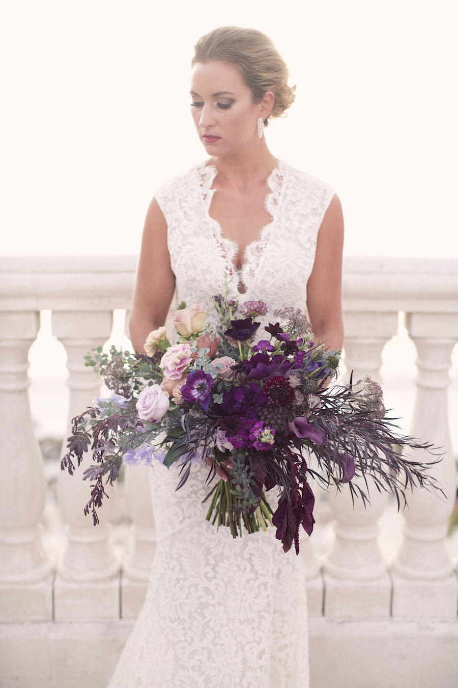 Lace Wedding Dress from The Bride Tampa | Large Purple and Blush Pink Wedding Bouquet | Clearwater Wedding Photographer Djamel Photography