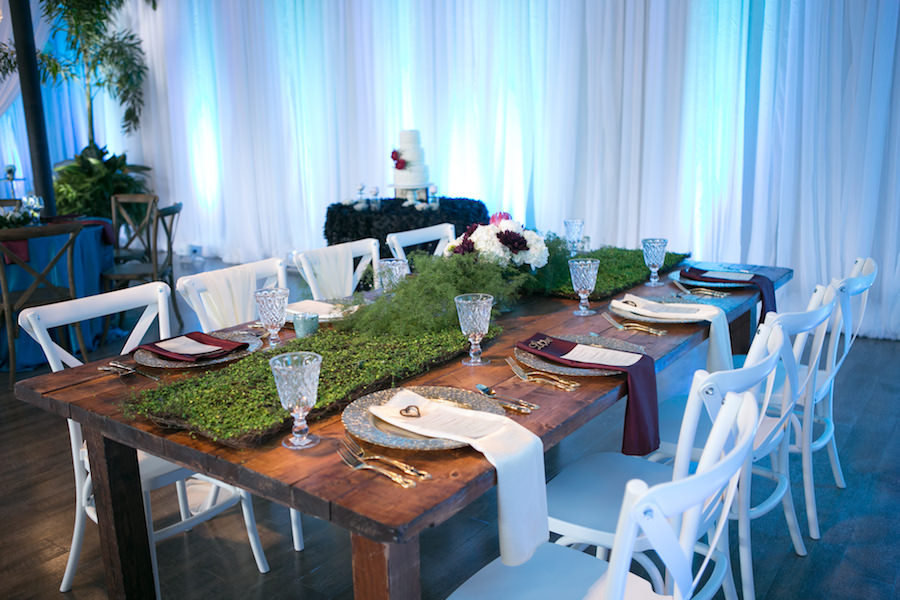 White French Country Chairs with Wooden Farm Tables and Moss Greenery Centerpiece | Boho Wedding Reception Decor Ideas and Inspiration | Tampa Wedding Venue Ivy Astoria | Chair Rentals A Chair Affair