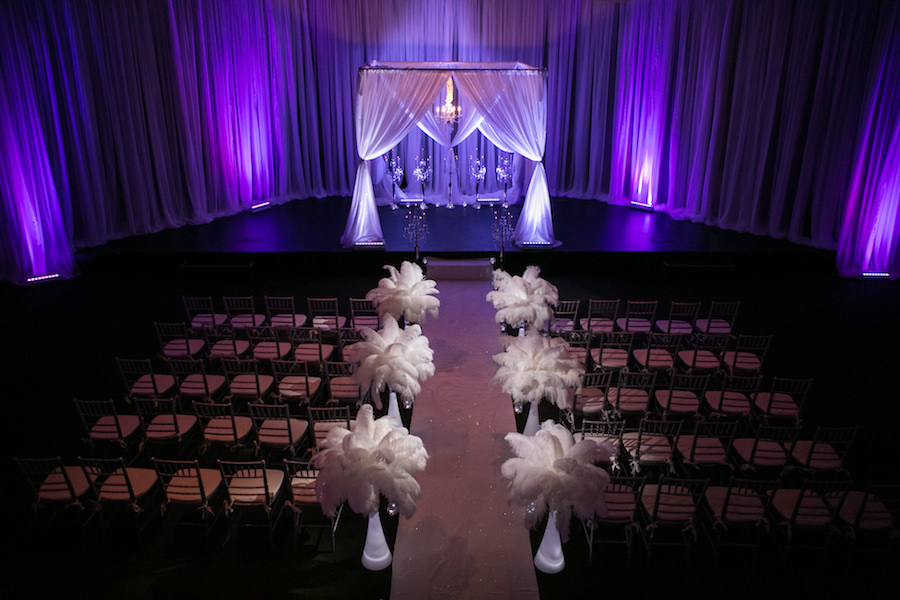 Purple Uplighting and Pin-spotting Lighting Effects for Florida Modern Wedding Ceremony with Drapery and Chiavari Chairs with Feather Aisle Decor by Tampa Event Rental Company Gabro Event Services
