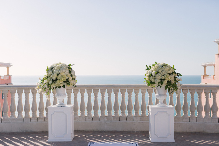 Classic, Elegant White Wedding Ceremony Decor Flowers on Pedestal | Clearwater Beach Hotel Wedding Venue | Hyatt Regency Clearwater Sky Terrace Outdoor Ceremony