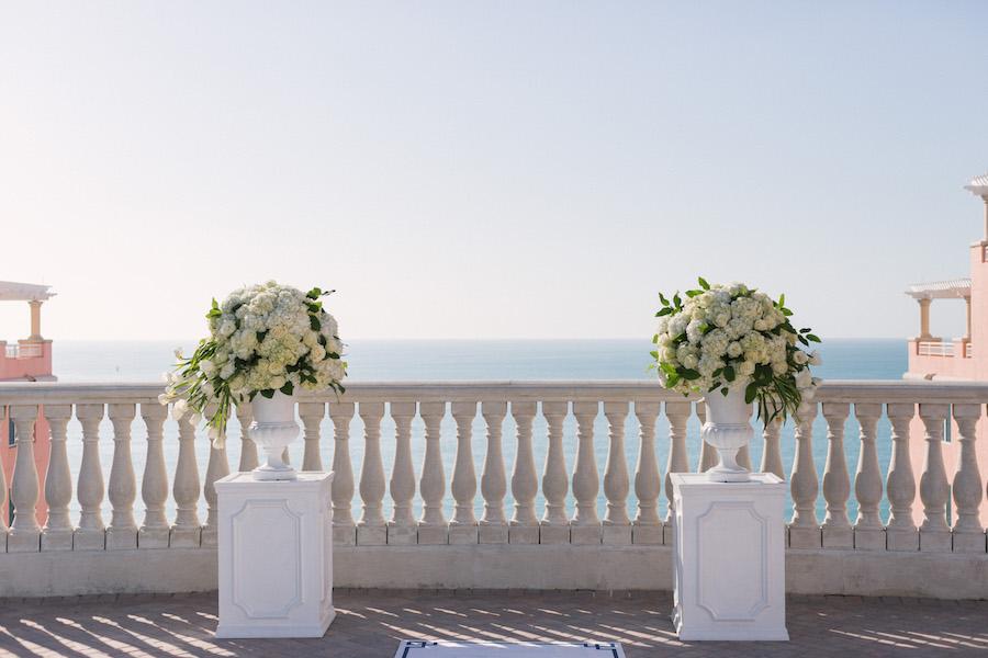 Classic, Elegant White Wedding Ceremony Decor Flowers on Pedestal   Clearwater Beach Hotel Wedding Venue   Hyatt Regency Clearwater Sky Terrace Outdoor Ceremony