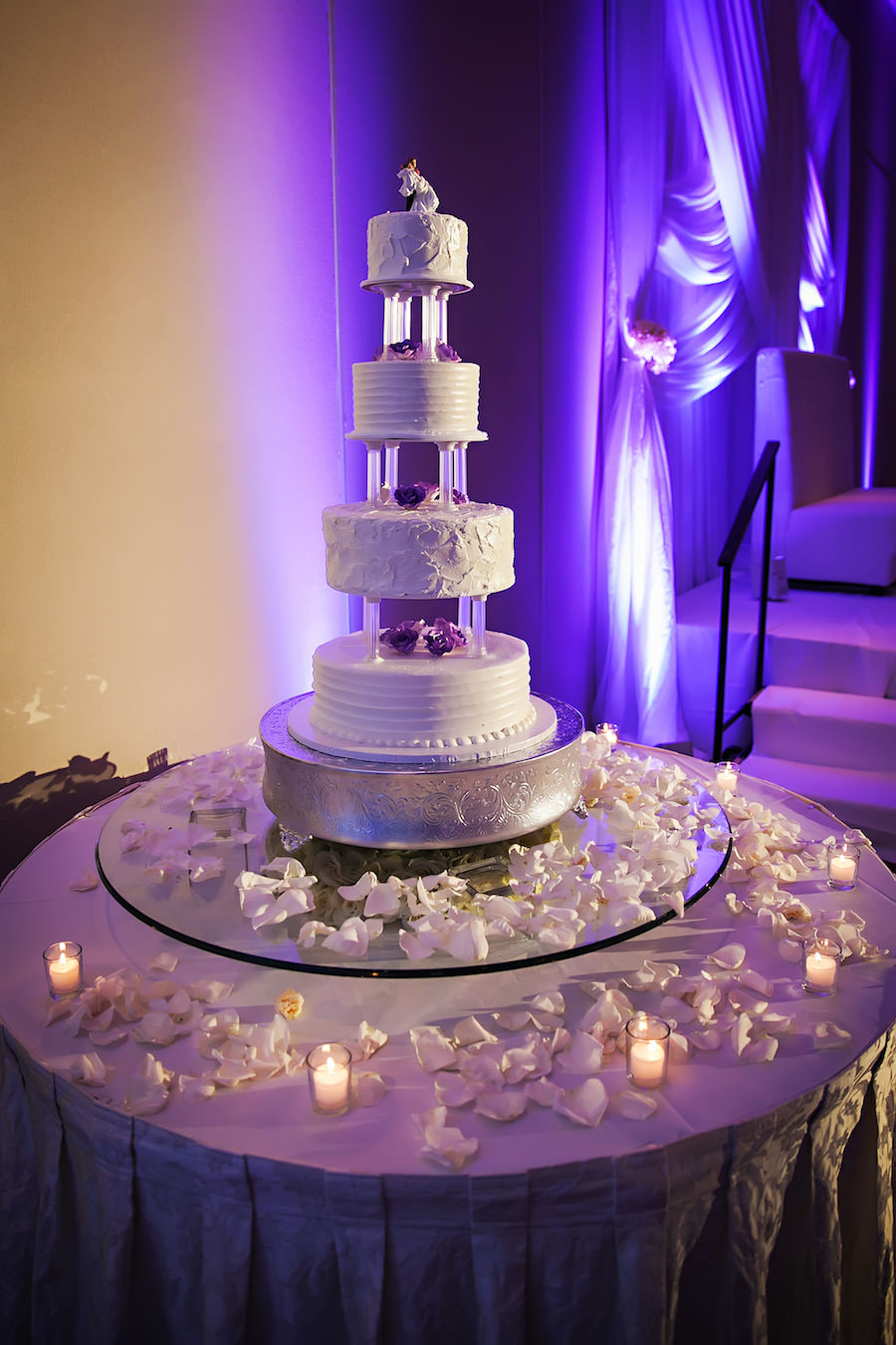Four Tiered, Round, White Wedding Cake with White Rose Petal Accents
