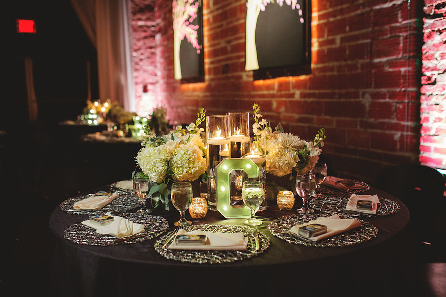 Modern Industrial Chic Wedding Reception Decor with Gunmetal and Ivory Centerpieces with Floating Candles, Silver Chargers and Lighted Marquee Letters | St. Petersburg Wedding Venue NOVA 535 | Iza's Flowers | Special Moments Event Planning | Rentals by Signature Event Rentals