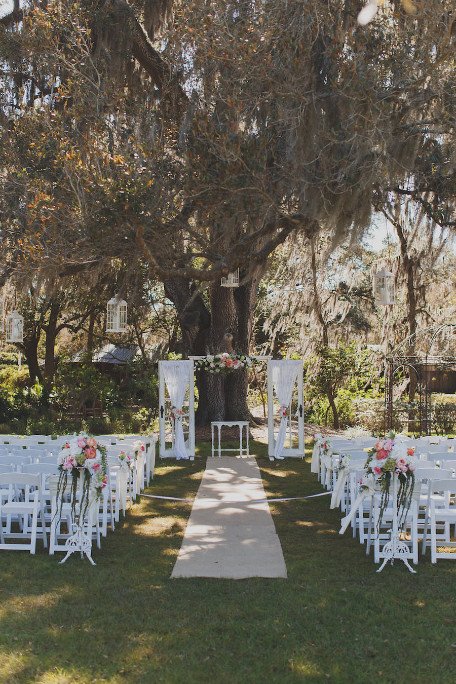 Rustic Outdoor Wedding Ceremony Inspiration | Vintage Door Pane with Draping and White Garden Chairs with Blush Pink and Salmon Flowers | Rustic Tampa Wedding Venue Cross Creek Ranch