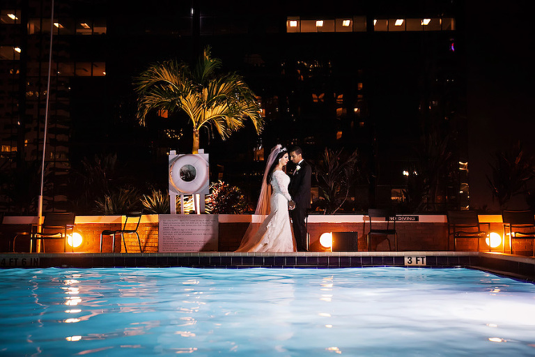 Outdoor, Nighttime, Bride and Groom Portrait by Rooftop Pool | Downtown Tampa Hotel Wedding Venue Hilton Downtown | Wedding Photographer Limelight Photography