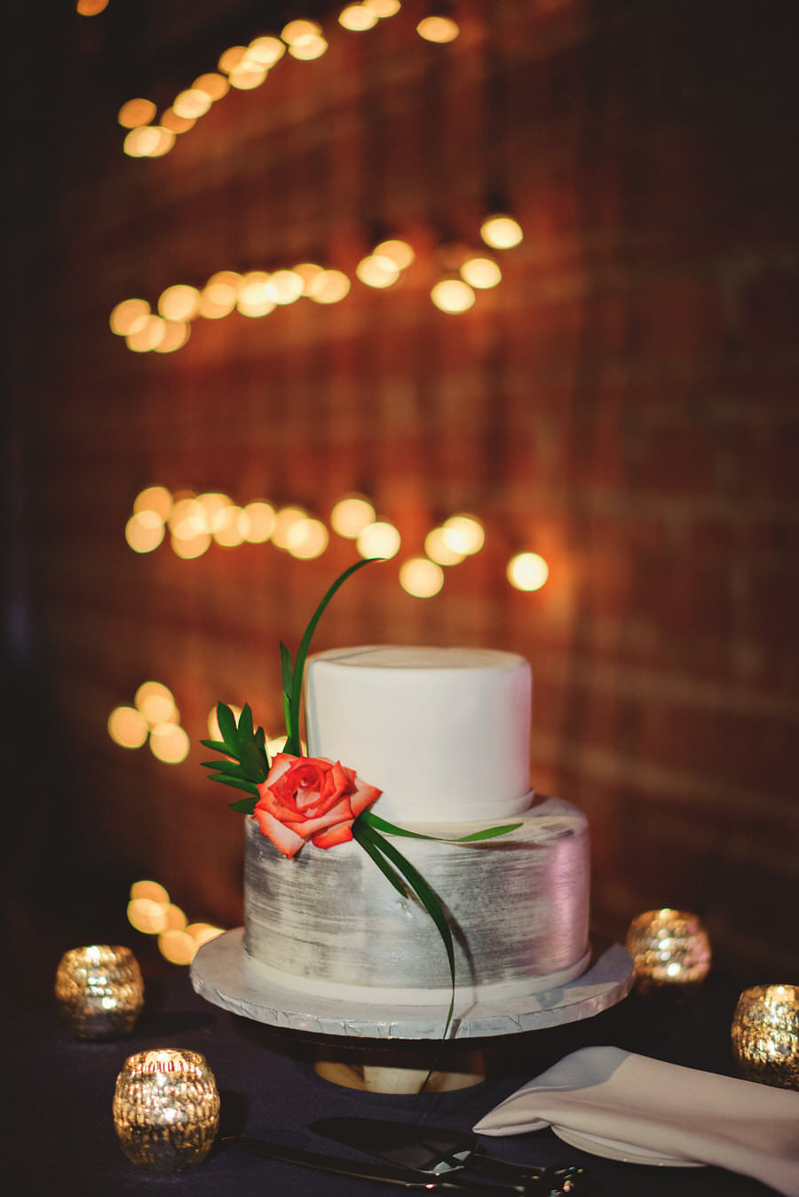 Monder Chic-Inspired Two Tier Round White and Silver Wedding Cake with Rose Accent