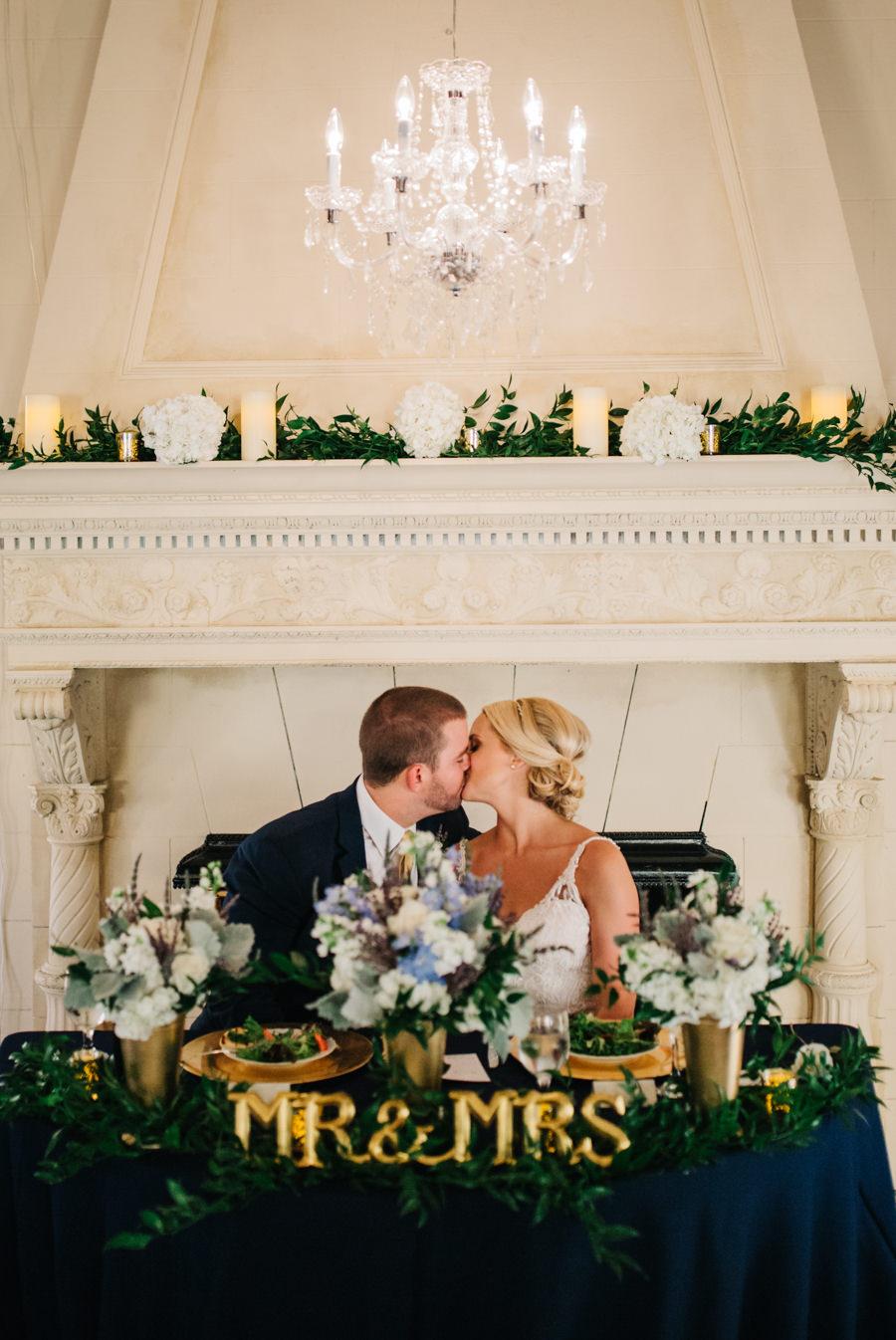 Sarasota Bride and Groom Portrait at Wedding Reception Sweetheart Table | Sarasota Wedding Florist Apple Blossoms Floral Designs | Wedding Planner Nicholle Leonard Designs