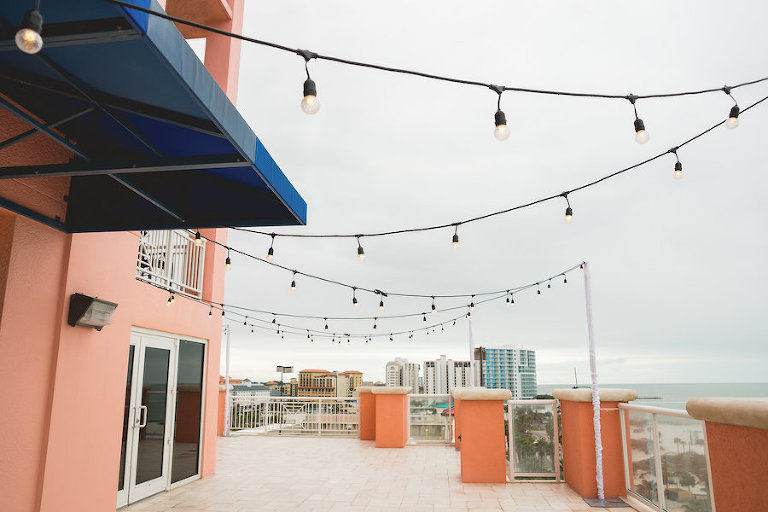 Rooftop Oceanfront Tampa Bay Wedding Reception with String Lights | Waterfront Wedding Venue Hyatt Regency Clearwater Beach | Gabro Event Services