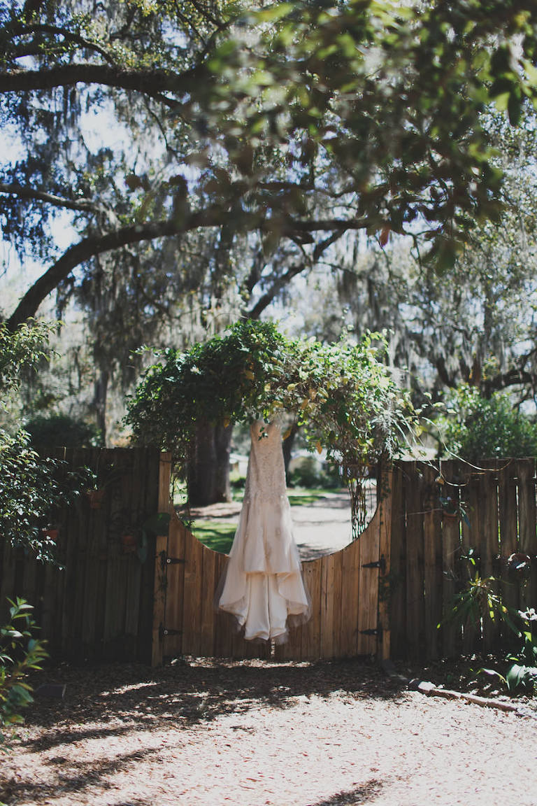 Cream Beaded Sweetheart Trumpet Wedding Dress in Rustic Setting with Trees