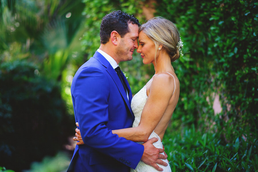 Bride Open Back Wedding Dress and Groom in Blue Suit Wedding Portrait