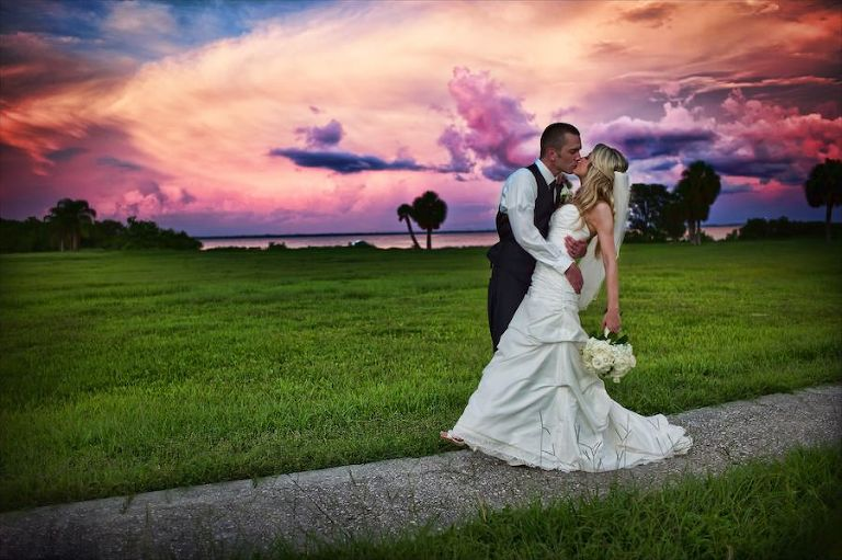 Bride and Groom Florida Sunset Wedding Portrait | Tampa Bay Waterfront Wedding Venue Safety Harbor Resort and Spa