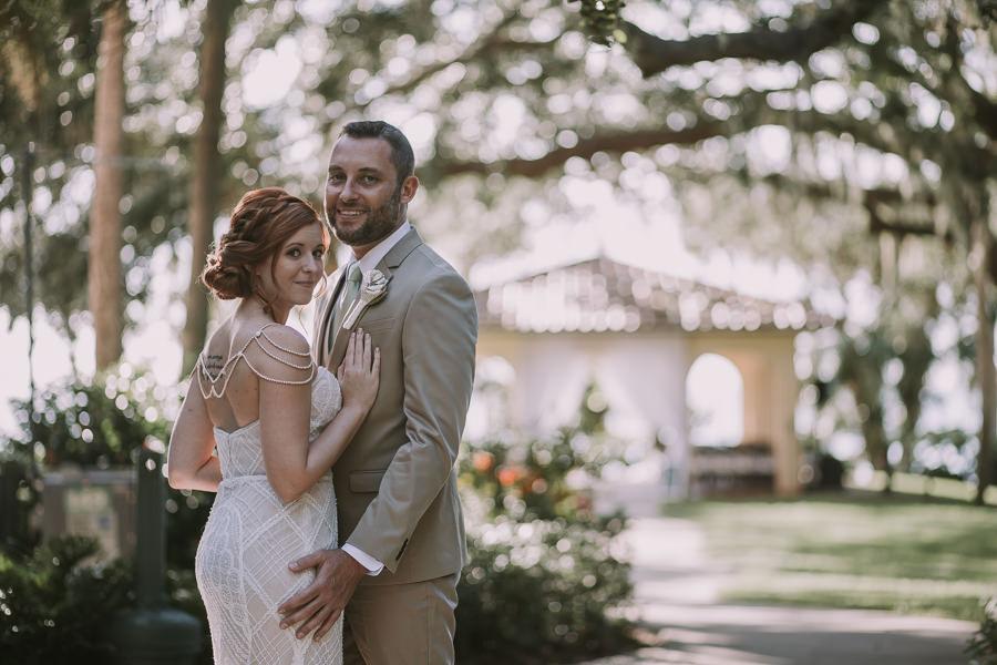 Bride and Groom Outdoor Florida Wedding Portrait | Sarasota Wedding Photographer Brandi Image Photography | Waterfront Sarasota Wedding Venue Powel Crosley Estate