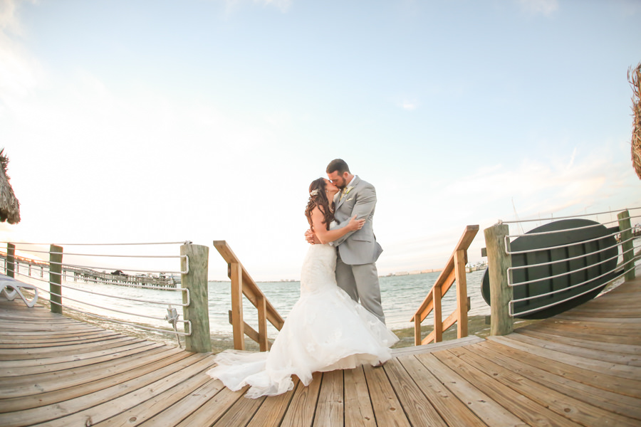 Outdoor, Bride and Groom Waterfront Wedding Portrait on Dock at St. Petersburg Wedding Venue Isla Del Sol Yacht and Country Club