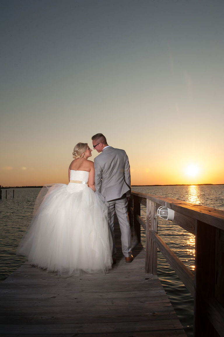 Outdoor, Sunset Wedding Portrait on Dock at Dunedin Waterfront Wedding Venue Beso Del Sol