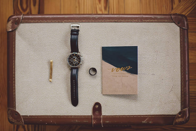 Groom Getting Ready Detail Wedding Portrait with Gold Tie Clip, Leather Watch, Rings and Vow Book