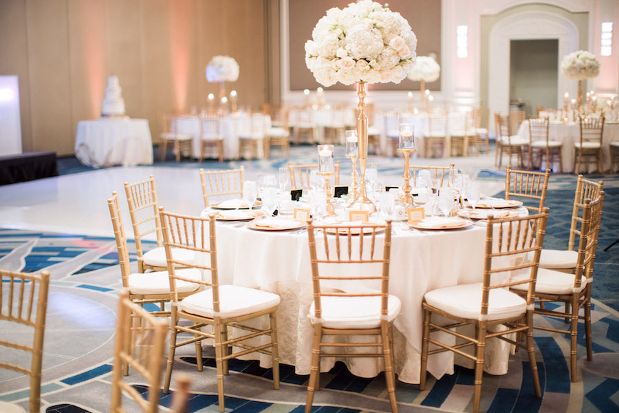 Tall Ivory Hydrangea and Rose Centerpiece Flowers in Gold Candelabra Vase with Ivory Linens and Gold Chiavari Chairs   Elegant Wedding Reception Decor   Sarasota Hotel Ballroom Wedding Venue Ritz Carlton