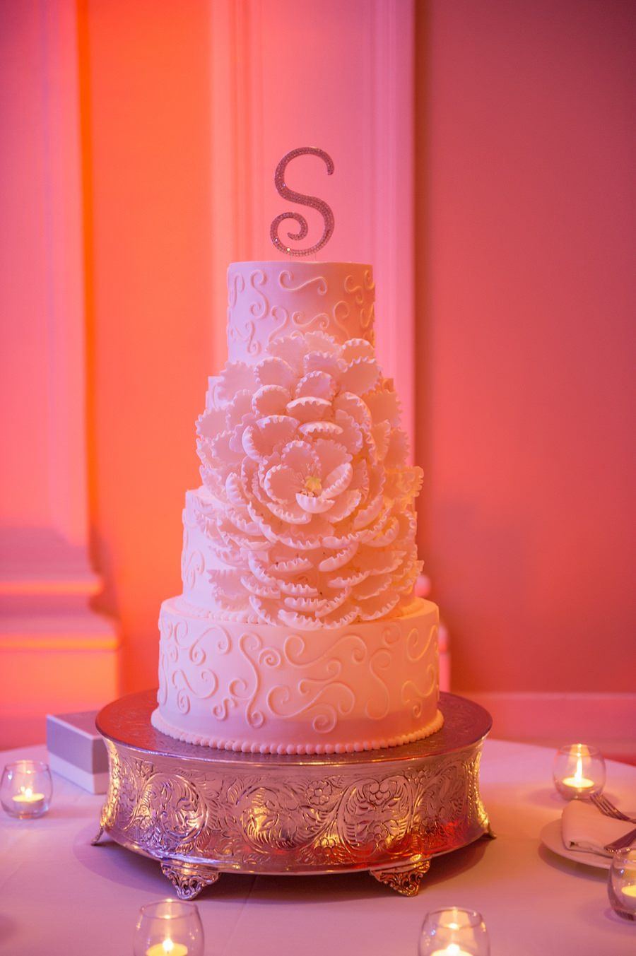 Four Tiered Round White Wedding Cake with Custom Lace Pattern and Blooming Sugar Flower with Sparkle Cake Topper
