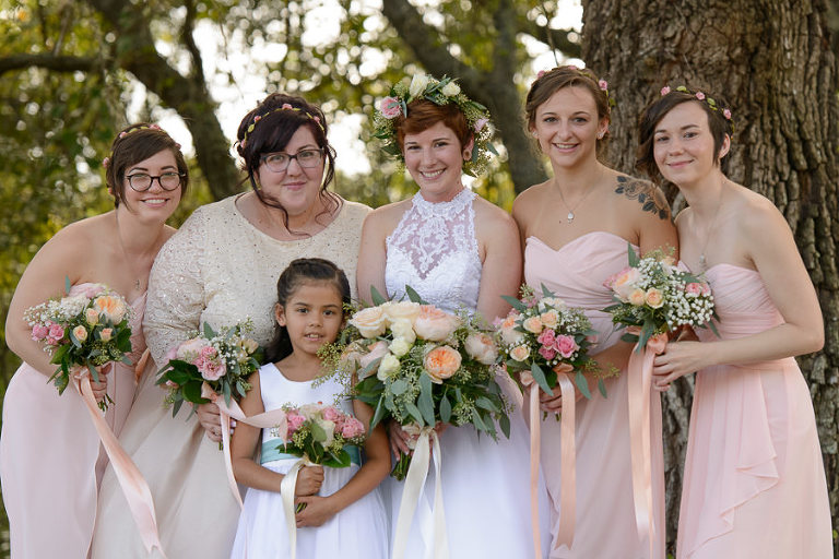 Bride and Bridesmaids in Blush Bridesmaids Dresses and Peach and Pink Floral Bouquets