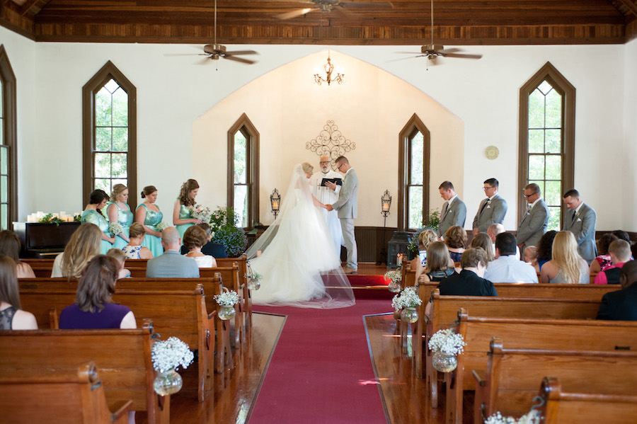 Bride and Groom Ceremony Exchanging Vows at Dunedin Historic Wedding Ceremony Church Venue St. Andrew's Memorial Chapel