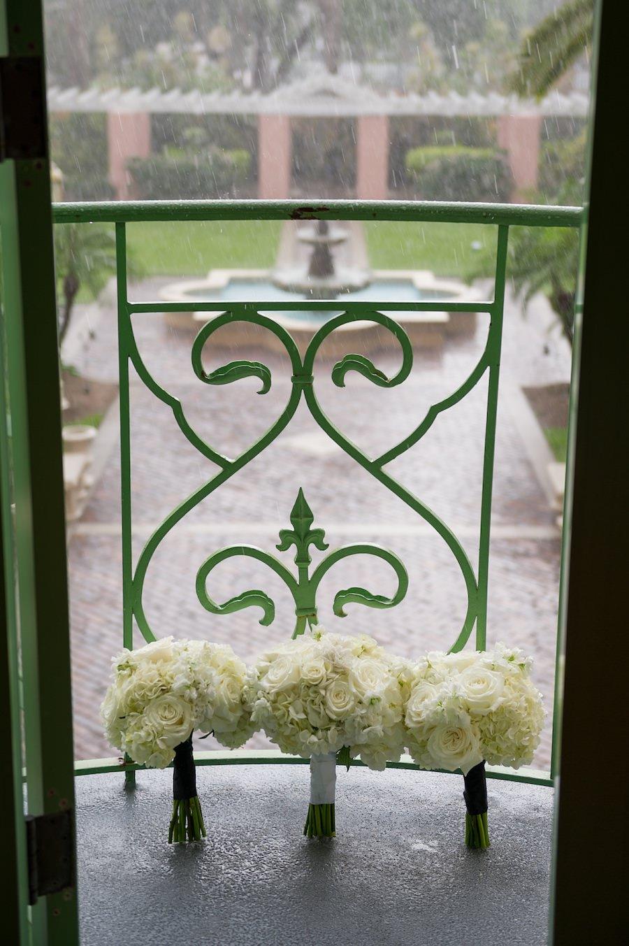 White Rose Wedding Bouquet on Vinoy Renaissance Balcony on Rainy Wedding Day