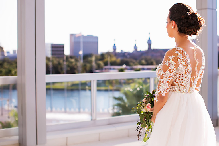 Bride Portrait in Illusion Wedding Dress Over Looking Downtown Tampa | Rooftop Wedding Venue The Glazer Children's Museum | Bridal Wedding Dress Shop Isabel O'Neil Bridal | Wedding Photographer Limelight Photography