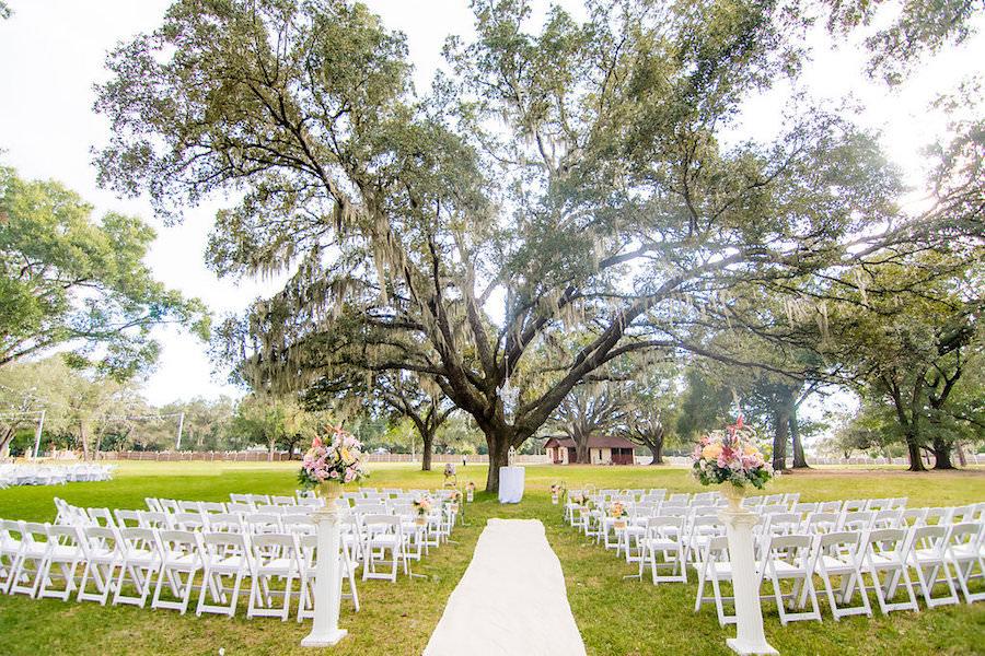 Outdoor Florida Wedding Ceremony under Spanish Moss covered Oak Tree   Outdoor Private Estate Wedding Venue in Brandon Florida  Tampa Bay Florida Wedding Venue Casa Lantana