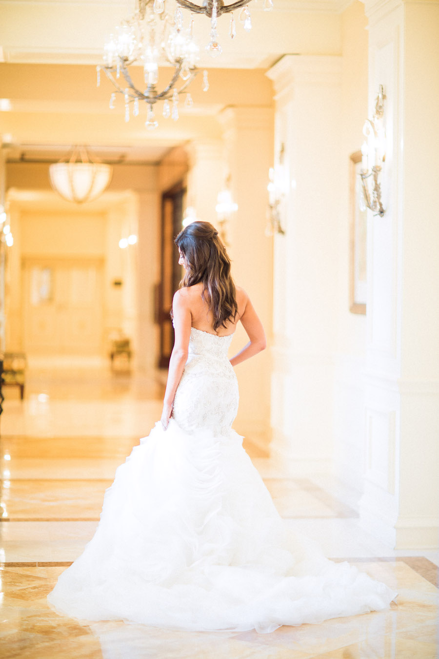 Bridal Wedding Portrait in White Beaded Trumpet Style Lazaro Wedding Gown with Horsehair Skirt
