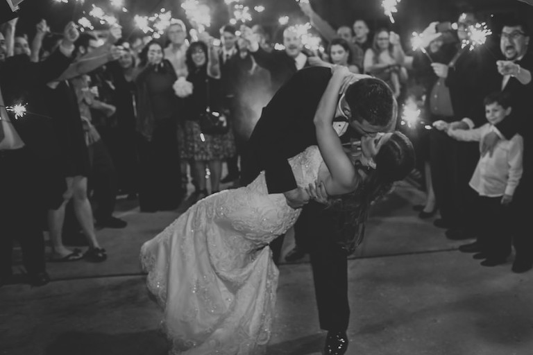 Outdoor Florida Wedding Bride and Groom Reception Farewell Kiss Portrait with Sparklers | Tampa Bay Wedding Photographer Brandi Image Photography