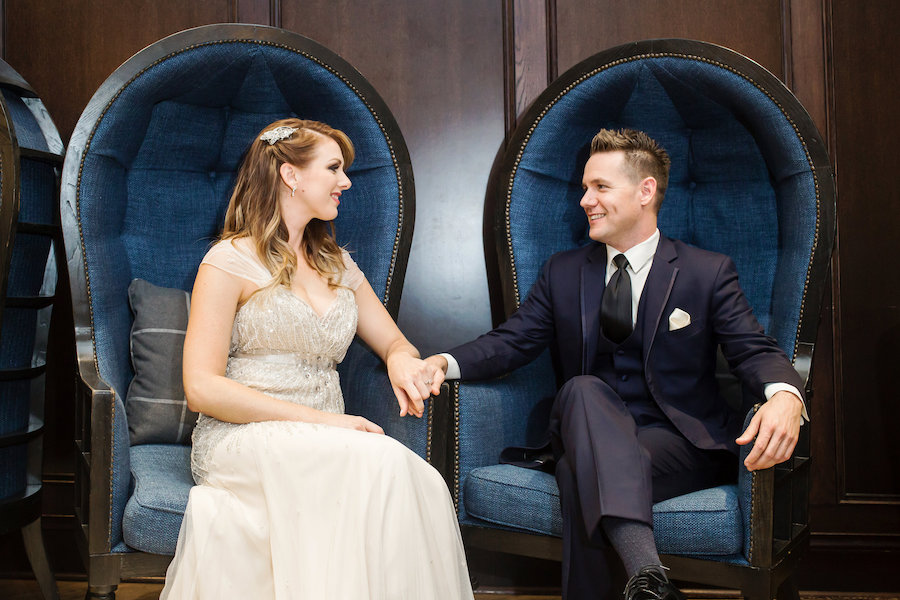 Art Deco Theme Bride and Groom Wedding Portrait in Navy Blue Suit and Ivory Beaded Jenny Packham Wedding Dress