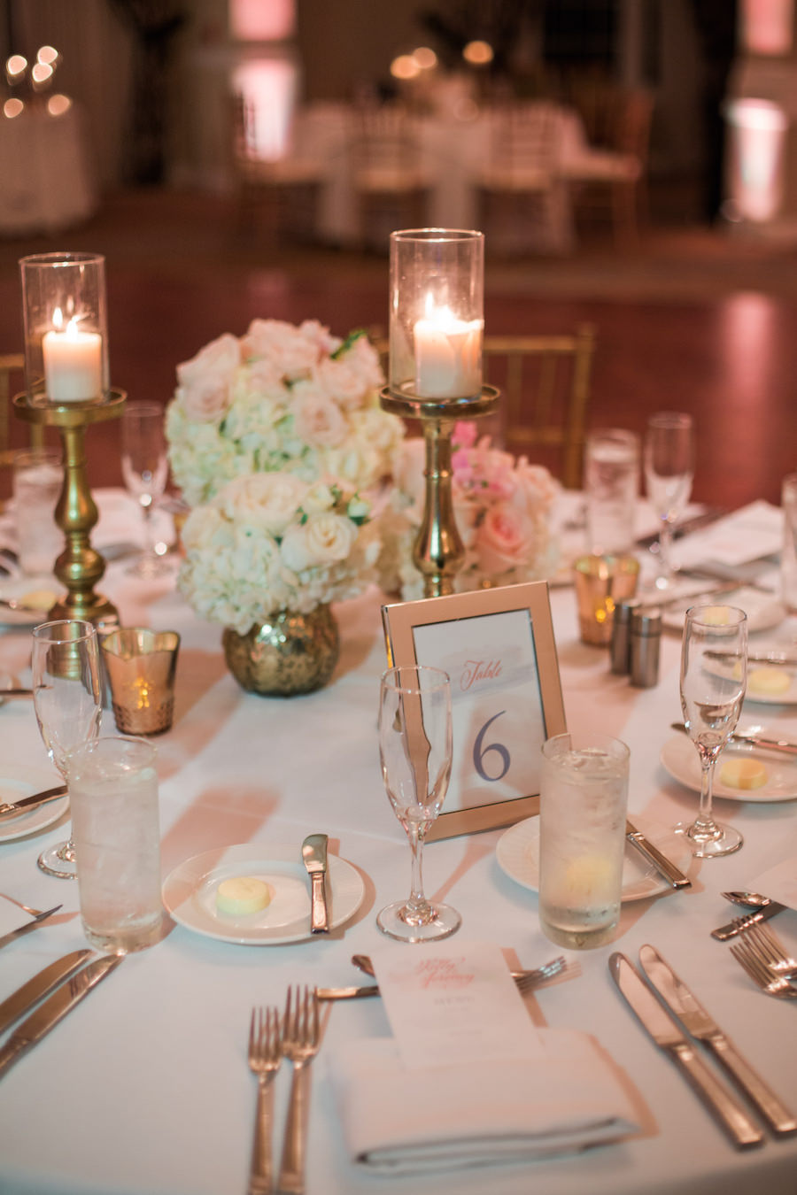White Hydrangea and Blush Pink Rose Centerpiece Flowers with Tall Candles and Gold Chiavari Chairs | Wedding Reception Decor Inspiration