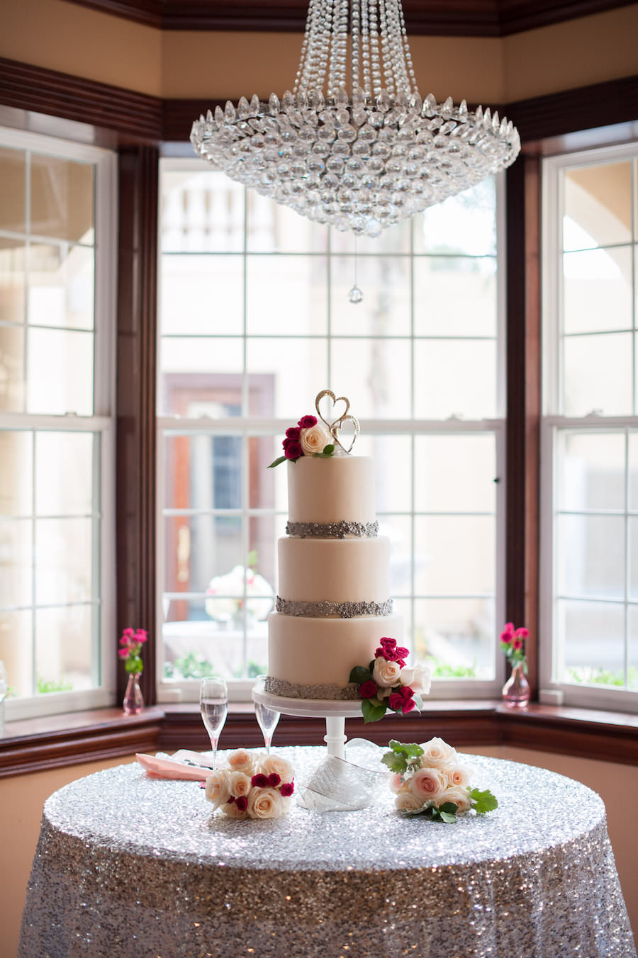 Three Tiered, White, Round Wedding Cake with Silver Accents and Ivory and Pink Flowers