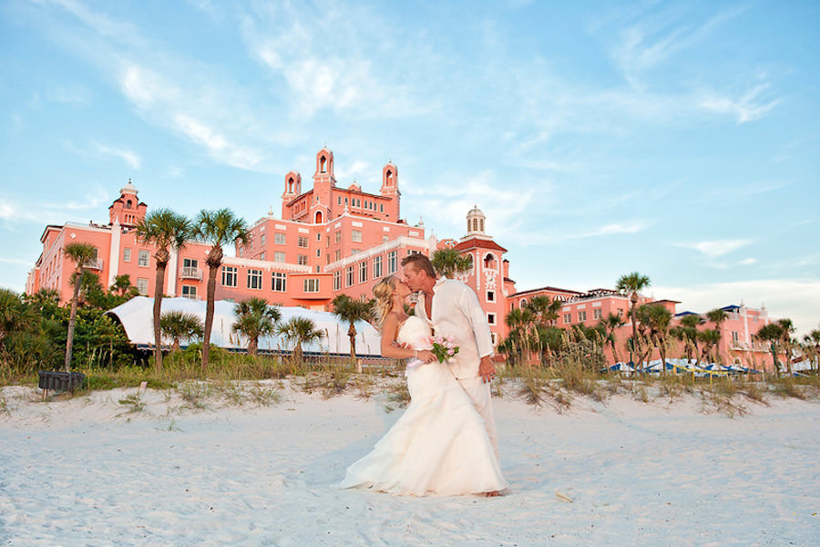 Bride and Groom Wedding Portrait at St. Pete Beach Wedding in front of Don CeSar Hotel | Tampa Beach Wedding and Florida Destination Wedding Planners Gulf Beach Weddings