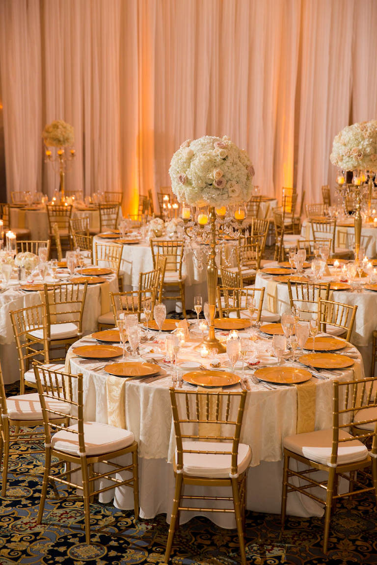 Elegant, Classic Traditional Gold and Ivory Wedding Reception Ideas and Inspiration with Tall Ivory Hydrangea Centerpieces and Gold Chiavari Chairs and Chargers | Downtown Tampa Wedding Venue The Floridian Palace | Tampa Wedding Planner by Blush by Brandee Gaar